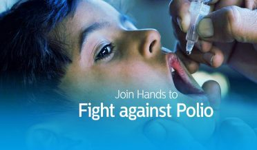 Health Worker Drop The Polio Vaccine in the mouth of kid,
